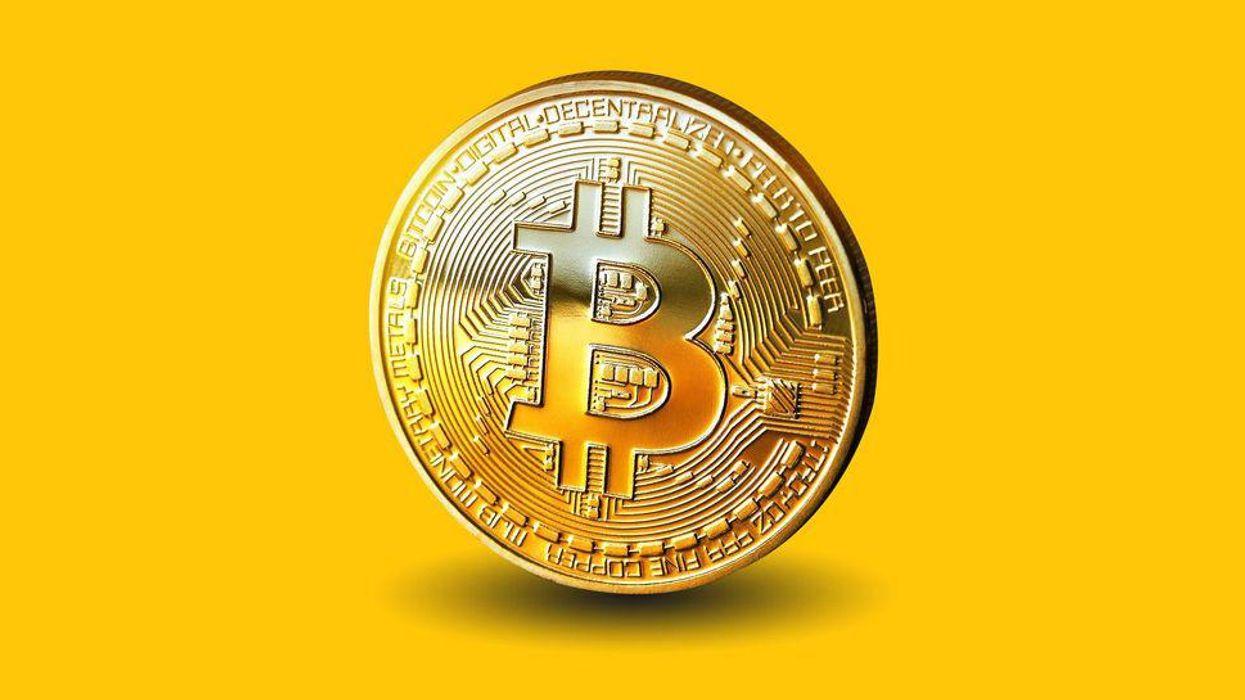 A souvenir coin representing the bitcoin cryptocurrency.