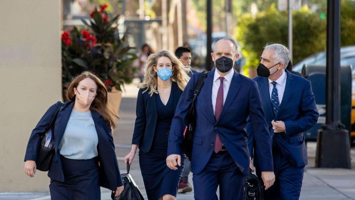 Theranos founder Elizabeth Holmes arrives at the Robert F. Peckham Federal Building with her defense team on August 31, 2021 in San Jose, California