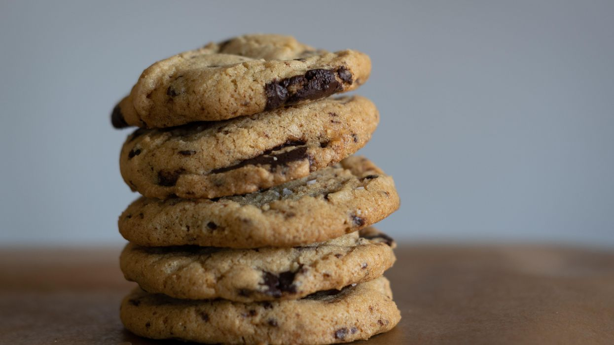 A stack of five chocolate chip cookies.