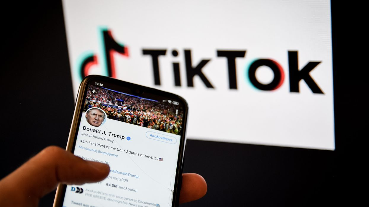 Trump's Twitter account on a phone in front of the TikTok logo
