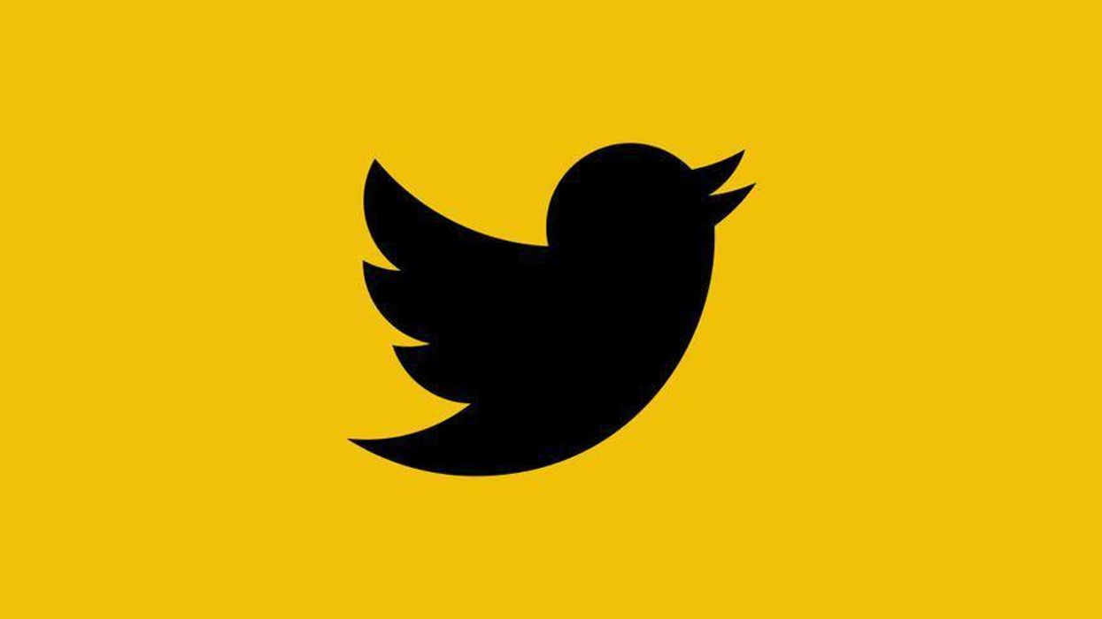 The Twitter logo in black on a yellow background.