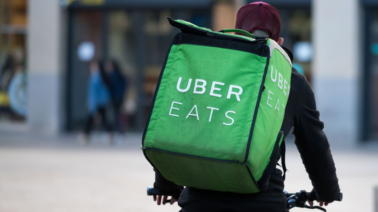 An Uber Eats courier riding a delivery bike