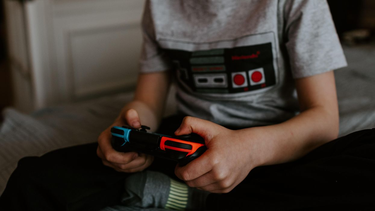 Person holding game controller