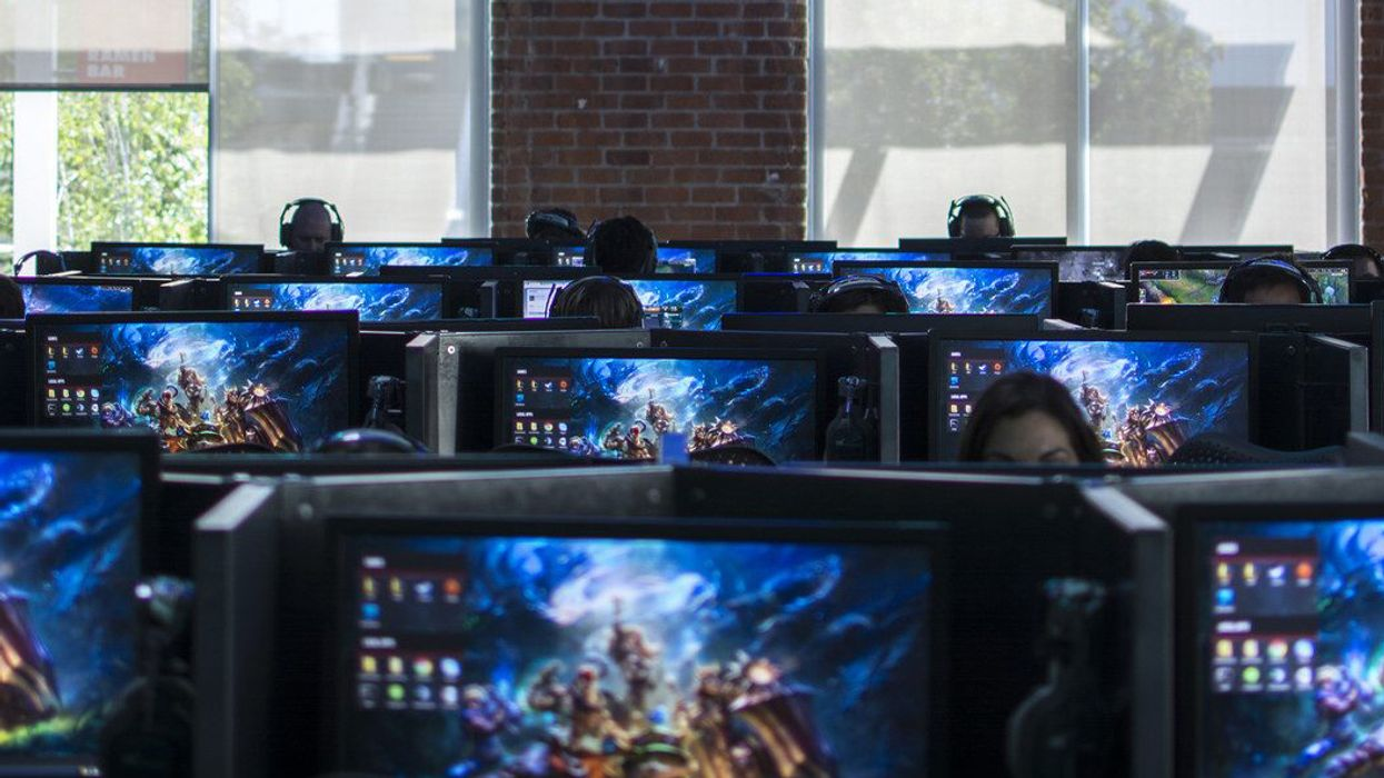 video games on screens in a pc cafe