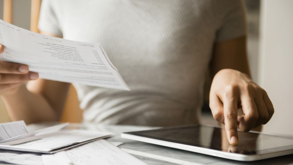 Woman reads bill and pays via tablet
