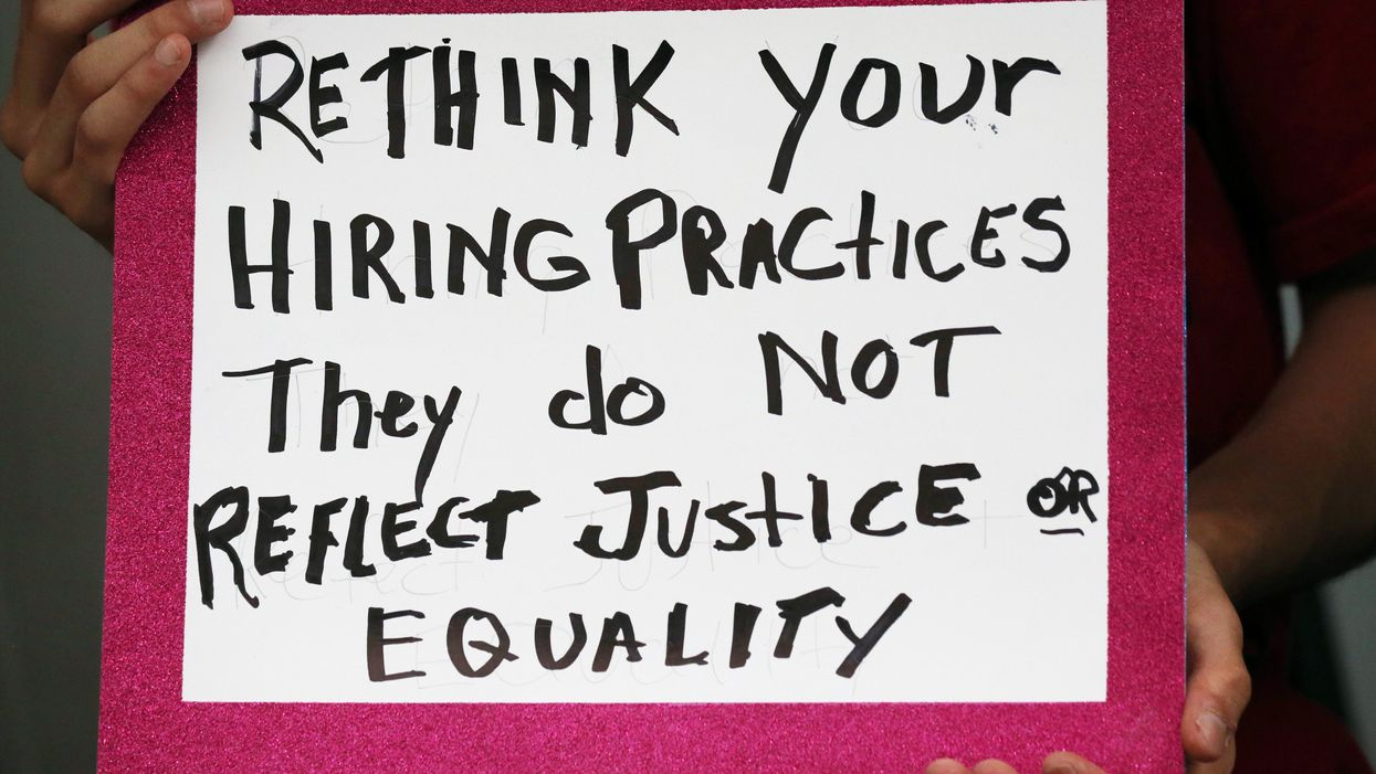 Sign that says rethink your hiring practices they do not reflect justice or equality